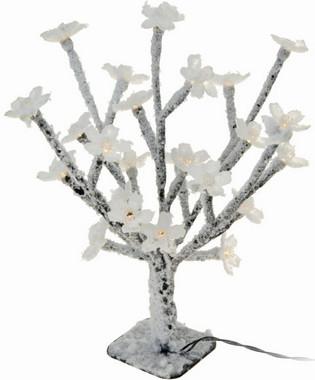 Stromek s květy svítící s umělým sněhem